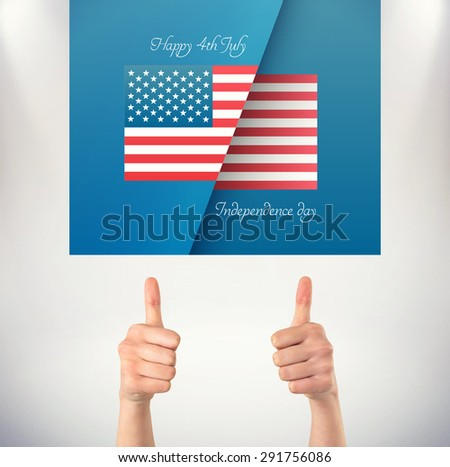 Businesswomans hands showing thumbs up against grey background
