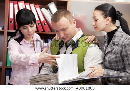 businesswomen  and their male colleague discuss the business - stock photo