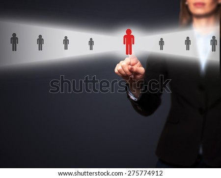 Businesswomen Hand select New Employee from Electronic interface using for Business technology, internet, networking, Recruitment and Workforce Concept. Isolated on black. Stock Image - stock photo
