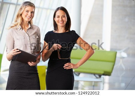 Businesswomen Having Informal Meeting In Modern Office - stock photo