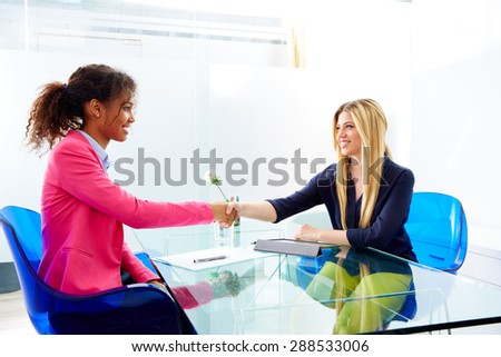 businesswomen interview handshake multi ethnic africand and blond sitting at office - stock photo