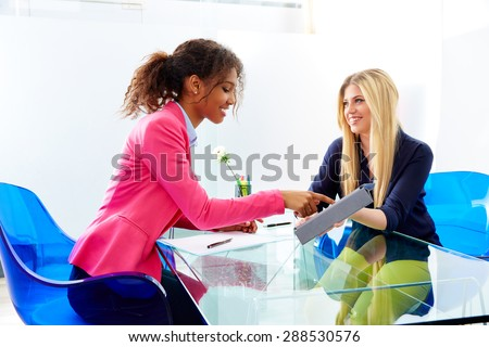 businesswomen interview meeting multi ethnic african and blond sitting at office - stock photo