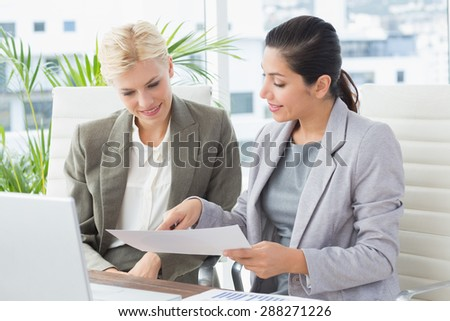 Businesswomen reading files in an office
