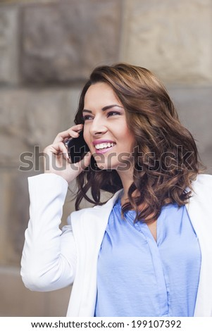 Businesswomen talking on the cell phone  - stock photo