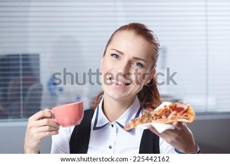 businesswomen with pizza - stock photo