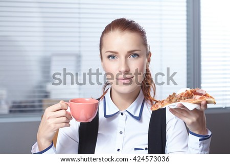 businesswomen with pizza
