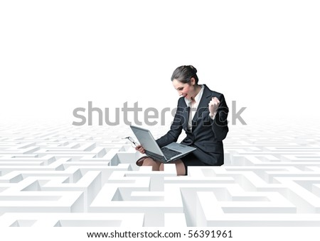 businesswon with laptop  in a 3d  labyrinth - stock photo