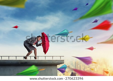 Businesswwoman protects herself from crisis - stock photo