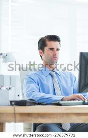 Busionessman using computer on his office