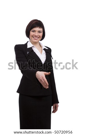 Busnesswoman going to shake your hand. Young friendly smiling business woman hanshake isolated on white background