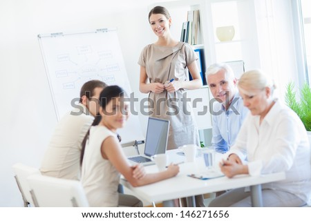 Busniess team in a meeting. - stock photo