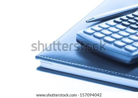 Bussines concept. Callendar book, ballpen and calculator    - stock photo