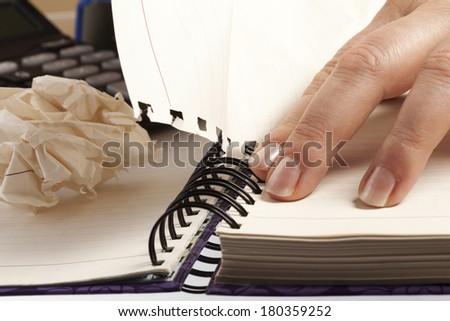 Bussines concept. Pulling sheets of notebook - stock photo
