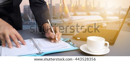 bussiness man working in office with  Industrial Container Cargo freight ship for Logistic Import Export concept - stock photo