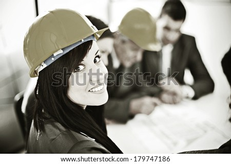 Bussiness people and architects having project meeting at office - stock photo
