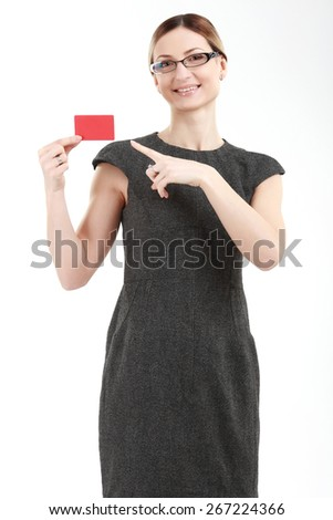 Bussinesswoman with a red plastic card - stock photo