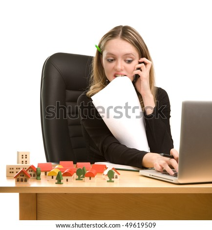 Bussineswoman with laptop, papers and cellphone - stock photo