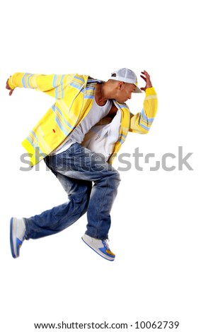 Bust A Move Young man with clothes in hip-hop style showing a dance move while jumping over pure white background. - stock photo