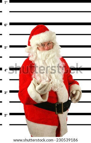 BUSTED. Santa Claus is arrested and his MUG SHOT taken at the Police Station. Santa was a Bad Bad boy.  - stock photo