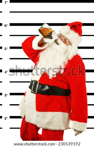 BUSTED. Santa Claus is arrested and his MUG SHOT taken at the Police Station. Santa was a Bad Bad boy. He was arrested for DUI. Driving his Sleigh under the Influence of Alcohol. Bad Bad Bad Santa  - stock photo