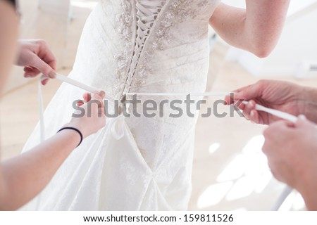 Bustling a Wedding Dress - stock photo