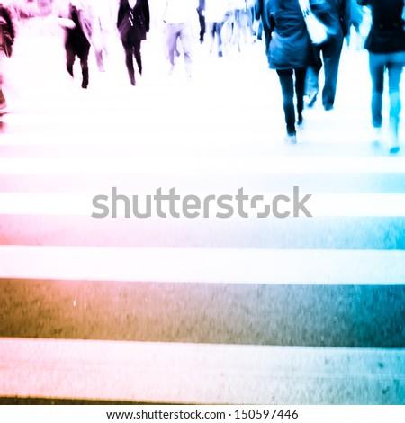 Busy big city street people on zebra crossing - stock photo