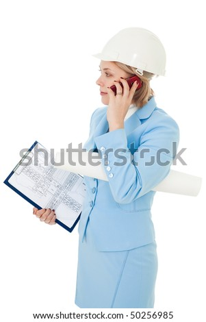Busy business architect woman with papers calling by phone
