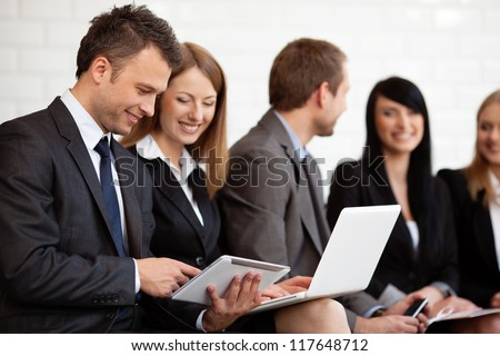busy business people working digital tablet and laptop. Selective focus - stock photo