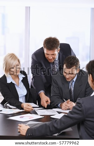 Busy business people working together, talking on office meeting.? - stock photo