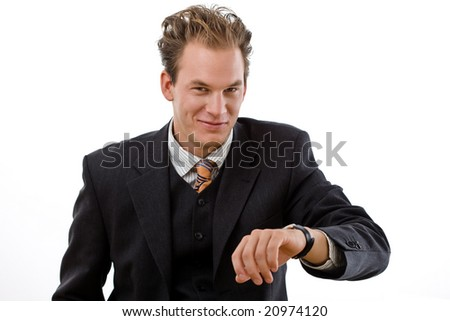 Busy businessman checking time, white background. - stock photo