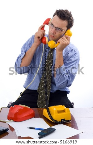 Busy businessman talking on two telephones in the same time