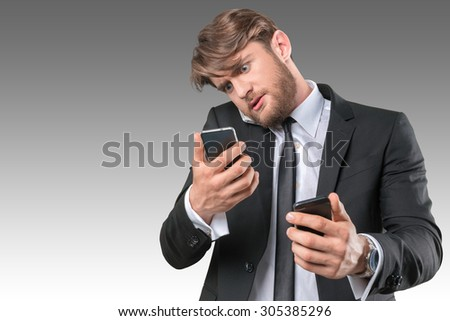 Busy businessman talking several phones same time - stock photo