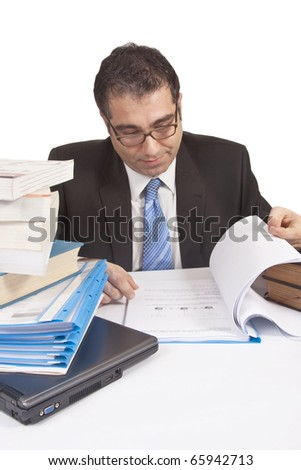 Busy businessman working with files - stock photo