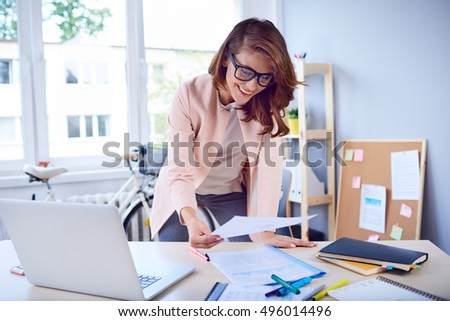 Busy businesswoman working by desk at office