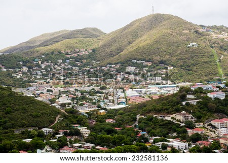Busy city among green tropical hills on St Thomas - stock photo