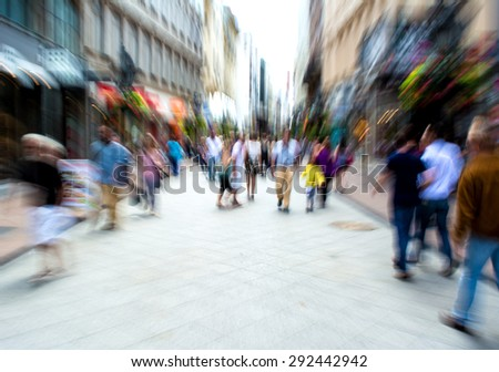 Busy city people going along the street. Intentional motion blur - stock photo