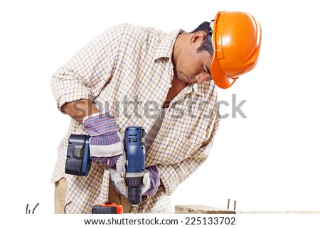 Busy construction worker using a drilling tool.Isolated in white background. - stock photo
