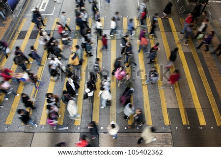 Busy Crossing Street in Hong Kong, China. - stock photo