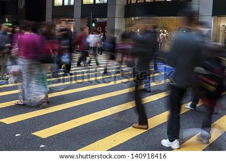 Busy Crossing Street in Hong Kong, China. - stock photo