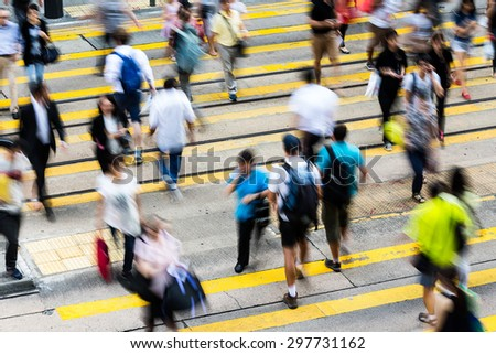 Busy Crossing Street in Hong Kong, China - stock photo