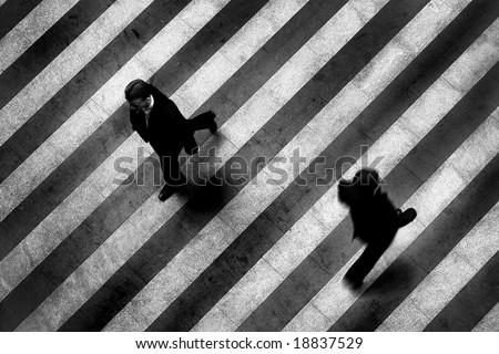 Busy crosswalk scene on the stripped floor - stock photo