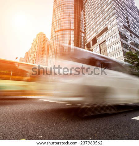 busy crosswalk scene with blur motion - stock photo