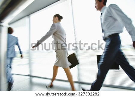 Busy employees moving for work in the morning