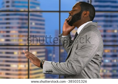 Busy evening in the city. Calling home in the evening. Optimistic chief on the phone. No need to worry. - stock photo
