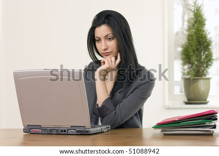 Busy female in office, with copy space - stock photo