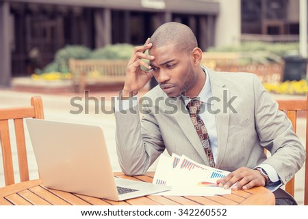 Busy man investment consultant analyzing company annual financial report balance sheet statement. Worried corporate employee working with documents graphs. Stock market, office, tax, economy concept.  - stock photo