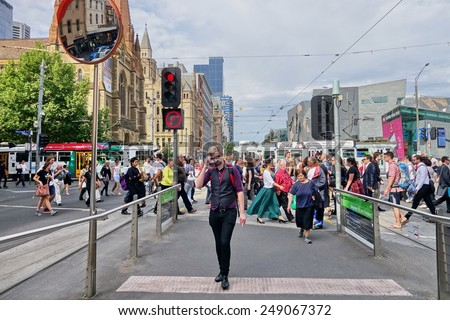 Busy morning on Flinder street on 31 October 2014. This is a central business area of city of Melbourne, Australia.
