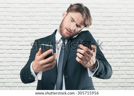 Busy office manager talking the phone - stock photo