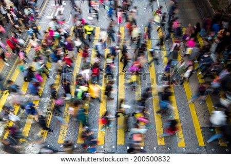 Busy pedestrian crossing at Hong Kong - stock photo