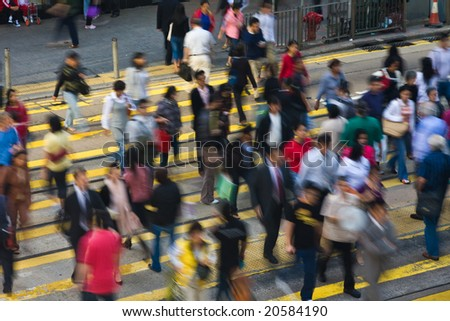 Busy pedestrian crossing in Hong Kong all faces unrecognisable - stock photo